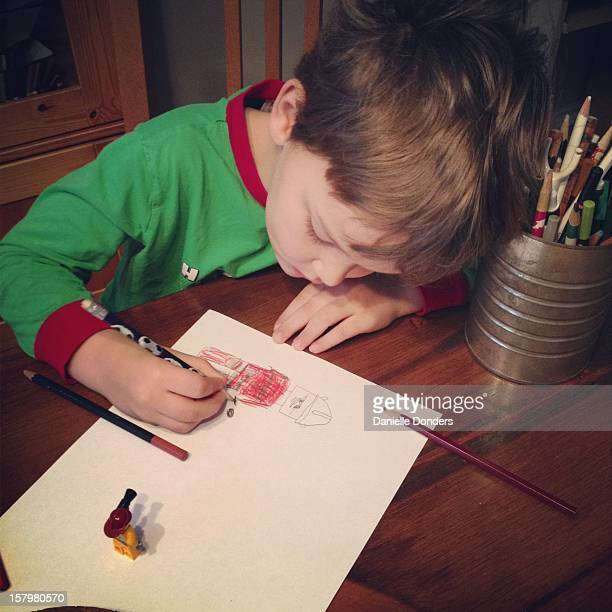 """little boy drawing cartoon figure - """"danielle donders"""" stock pictures, royalty-free photos & images"""