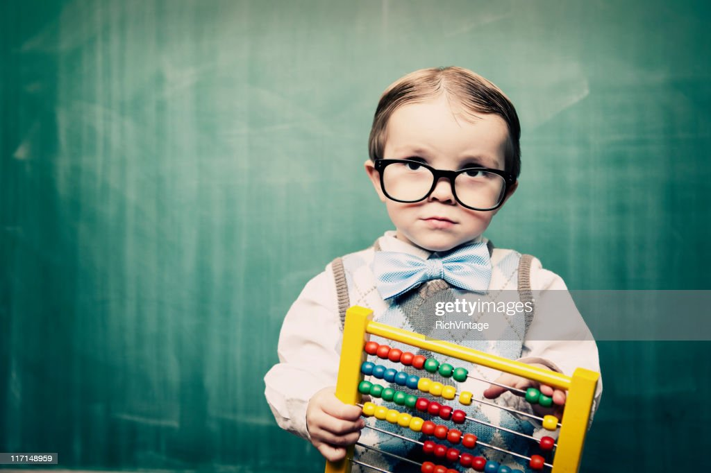 Little Boy Dressed as Acccountant using Abacus : Stock Photo
