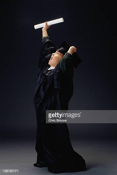 PERBE079 Little boy dressed as graduate