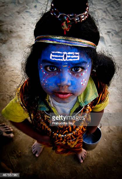 Little boy dressed as Shiva asking for alms from the pilgrims during the Maha Kumbh Mela held at Allahabad in India.