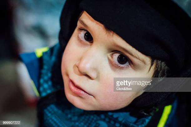 Little boy dressed in ski clothes