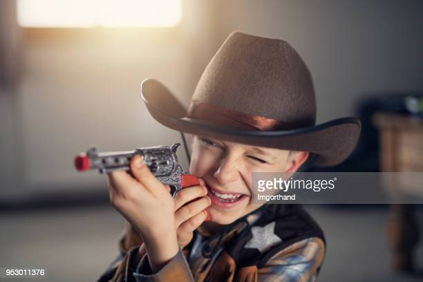 little boy dressed up as cowboy - letter d stock pictures, royalty-free photos & images
