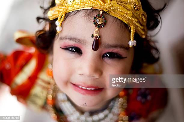 Little boy dressed up as Krishna