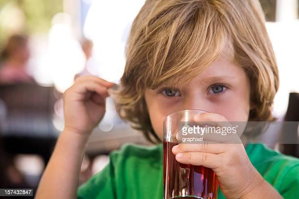 Little Boy (4-5) Drinking Glass of Fruit Juice
