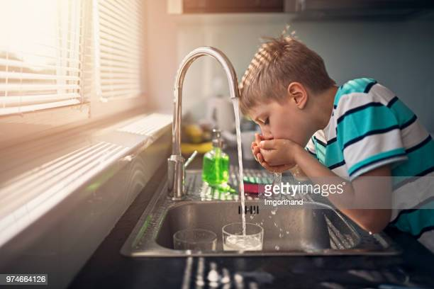 little boy drinking tap water - water stock pictures, royalty-free photos & images