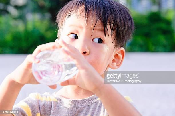 Little boy drinking water.