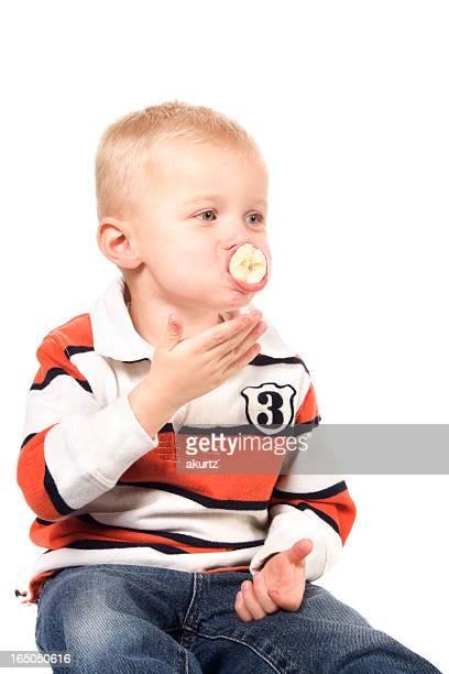 little boy eating a banana   XXL