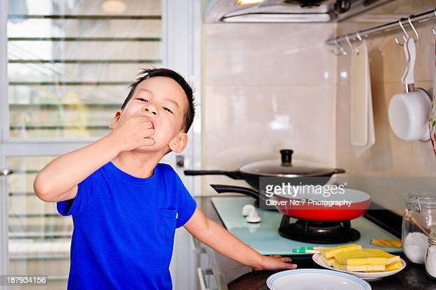 Little boy eating breakfast.
