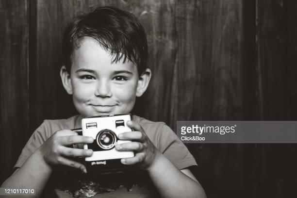little boy eating chocolate cookies indoors (snack) - click&boo fotografías e imágenes de stock