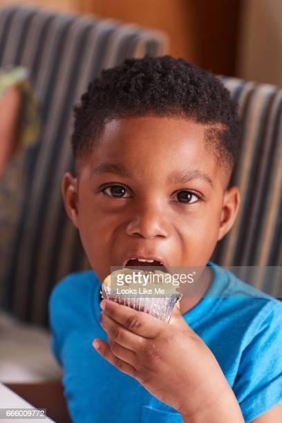 Little boy eating Easter cake.