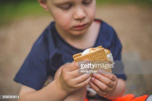 Little boy eating smore