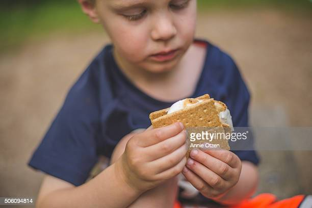 Little boy eating smore