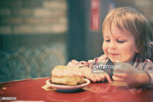 little boy enjoing a cake