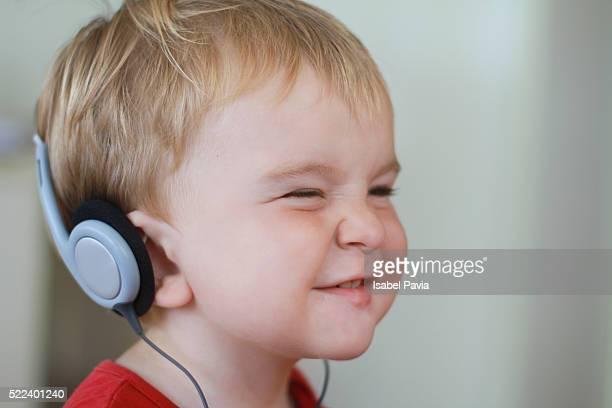 Little boy enjoying music