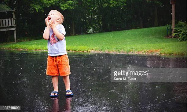 Little boy enjoying rain