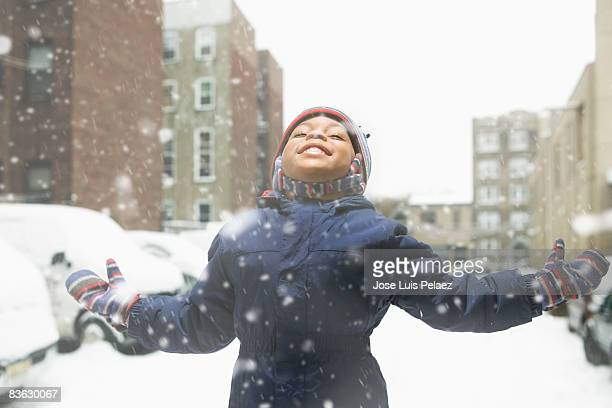 little boy enjoying snowfall - winter coat stock pictures, royalty-free photos & images