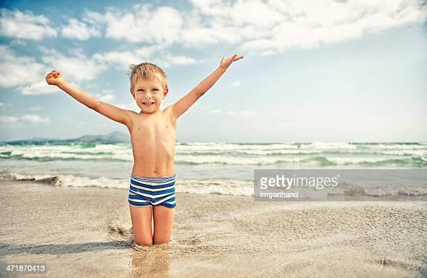 Little boy enjoying the sea