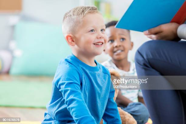 Little boy enjoys story time at day care
