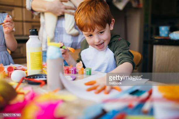 little boy finger painting - 4 girls finger painting stock pictures, royalty-free photos & images