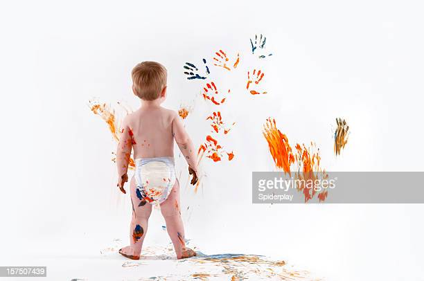 little boy fingerpainting - diaper kids stock pictures, royalty-free photos & images