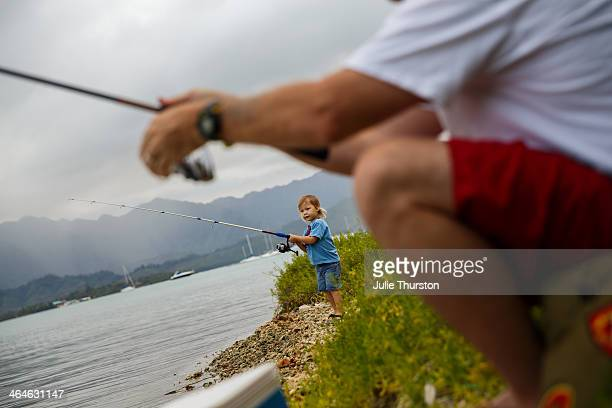 little boy fishing with grandpa in hawaii - kailua stock pictures, royalty-free photos & images