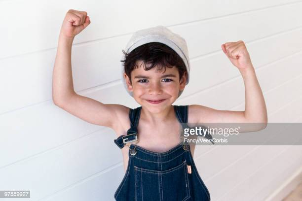 Little boy flexing his biceps