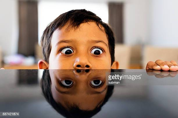 Little Boy Fooling Around At The Kitchen Counter