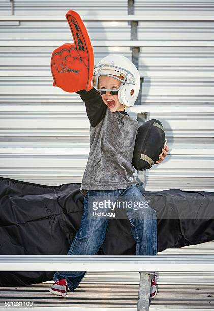 little boy football fan - foam finger stock photos and pictures