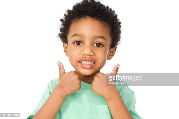 little boy gesturing thumbs up