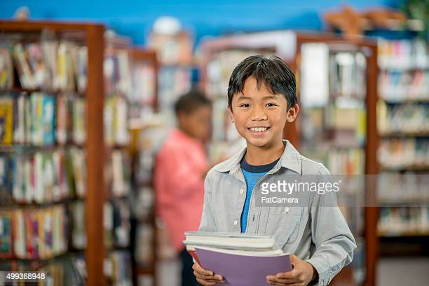 Little Boy Getting Books at the Library