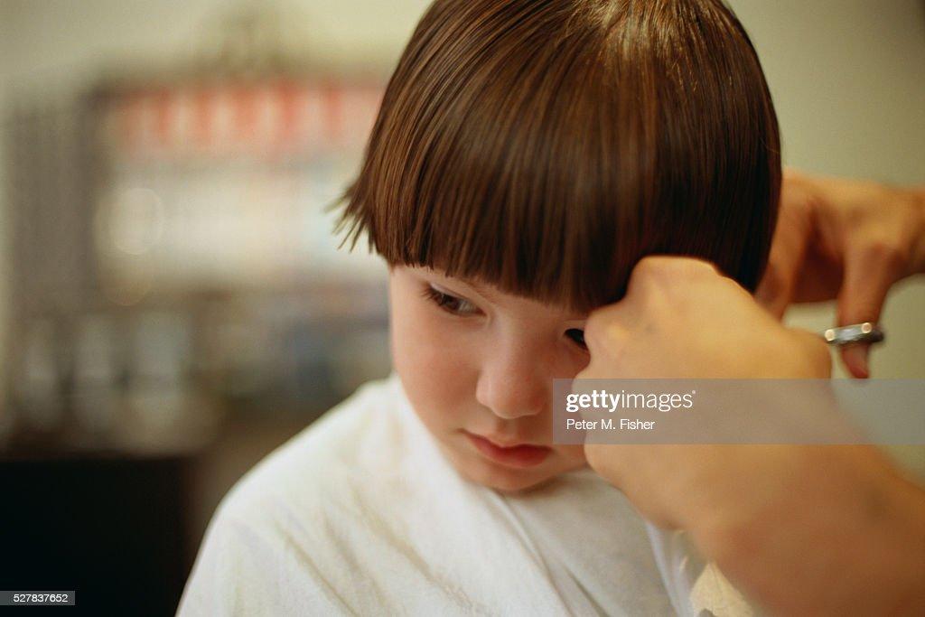 Little Boy Getting Haircut Stock Photo
