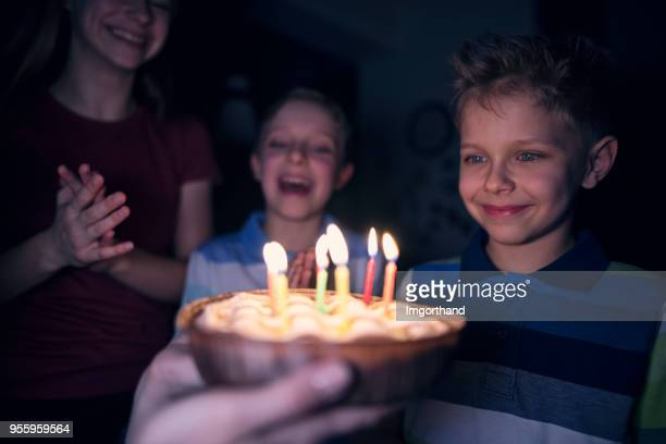 little boy getting his birthday cake - anniversary stock pictures, royalty-free photos & images