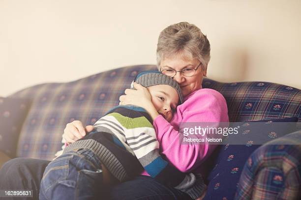 Little boy giving his grandma a hug