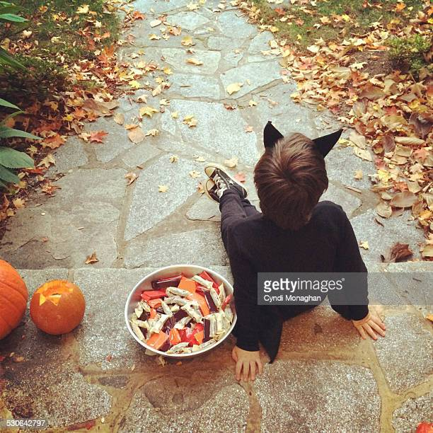 Little Boy Handing out Halloween Candy