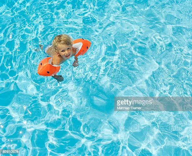 little boy happy learning how to swim
