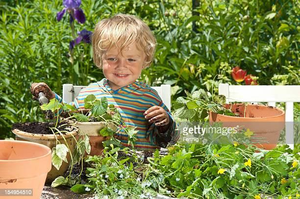 Little boy happy making a mess in the garden