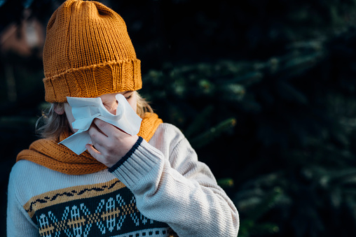 Little boy having a cold, blowing his nose - gettyimageskorea