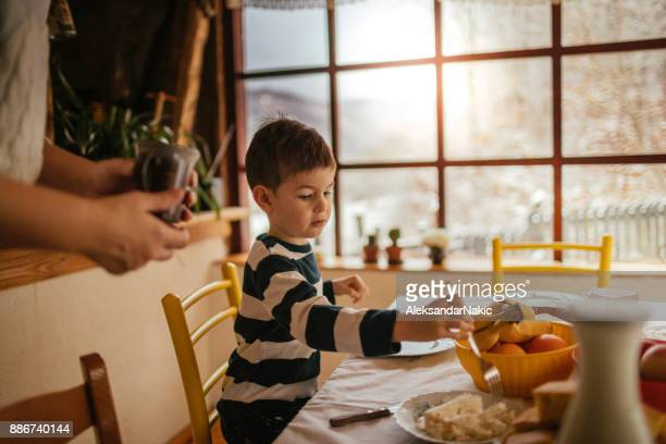 Little boy having breakfast