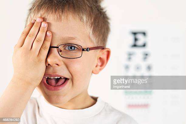 Little boy having eye exam.