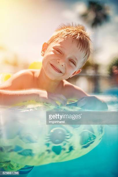 Little boy having fun in a swimming pool
