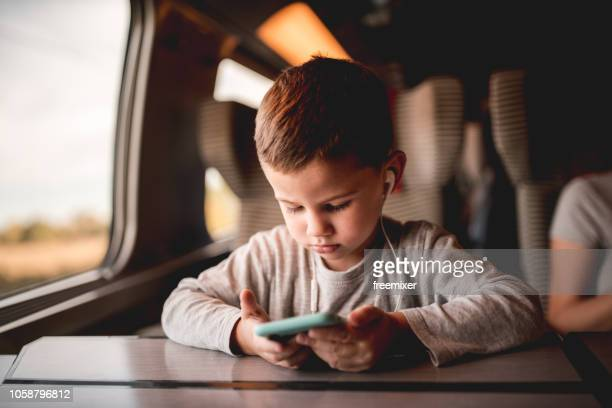 little boy having fun in the train - high speed train stock pictures, royalty-free photos & images