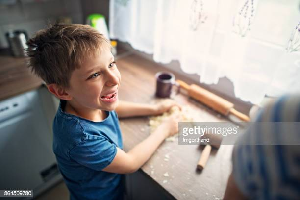 Little boy having fun making cookies
