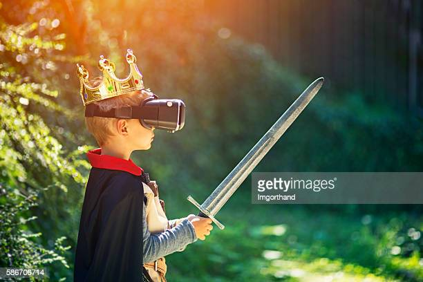 little boy having fun playing with virtual reality headset - reality kings stock pictures, royalty-free photos & images