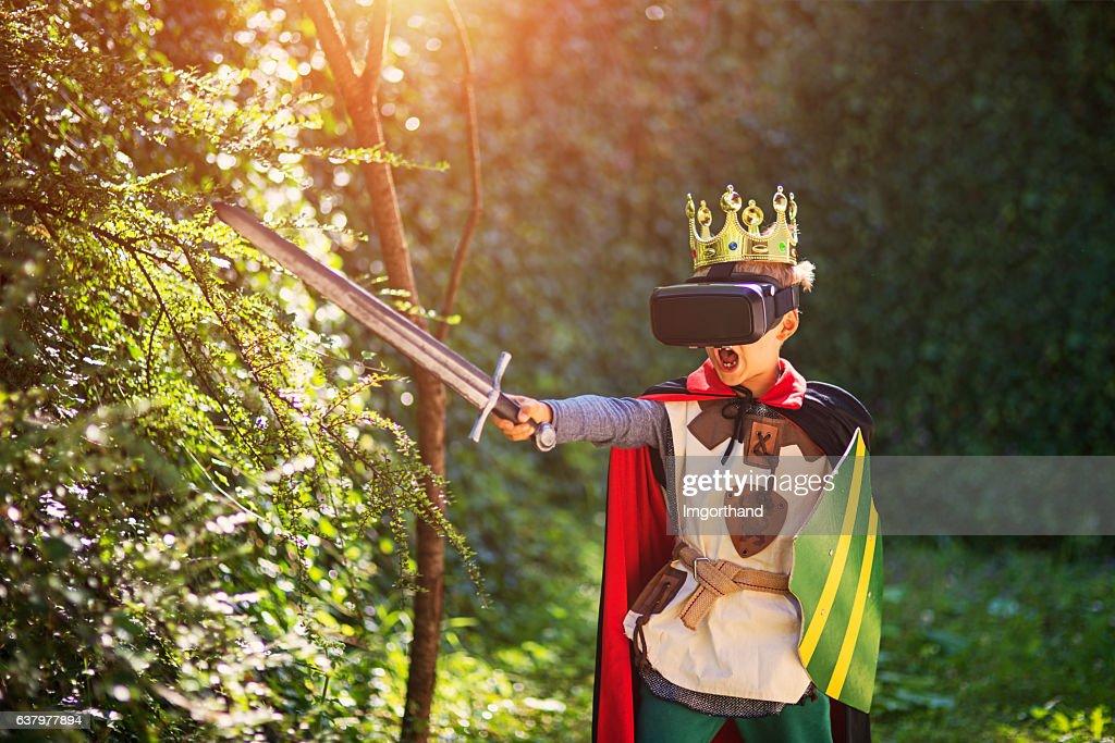 Little boy having fun playing with virtual reality headset : Stock Photo