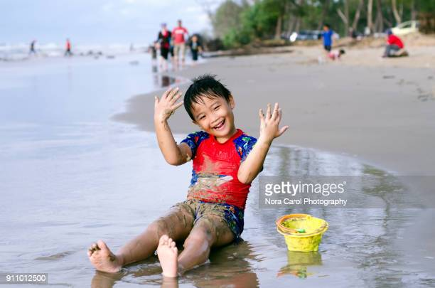 little boy having fun time at the beach - children only stock pictures, royalty-free photos & images