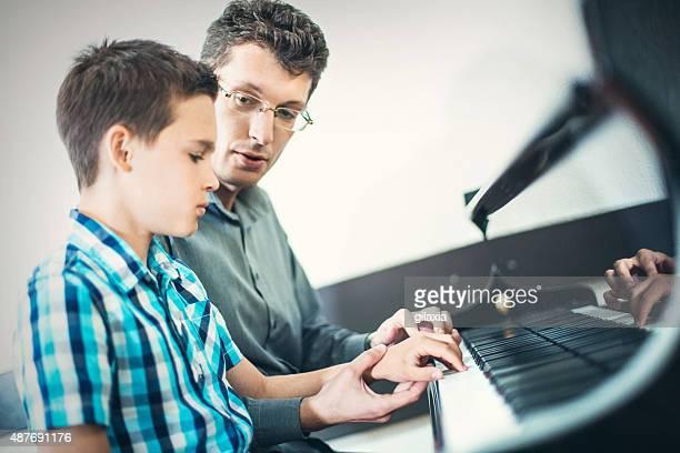 Little boy having piano lesson.