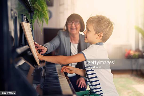 Little boy having piano lesson