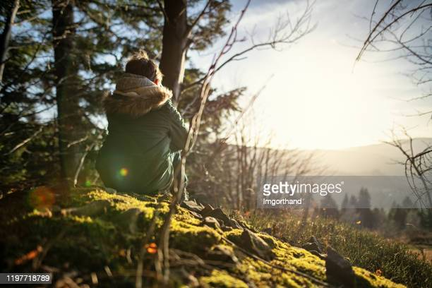 little boy hiker looking at view - khaki green stock pictures, royalty-free photos & images