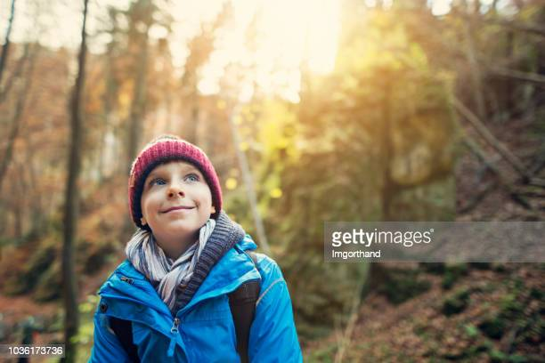 little boy hiking in autumn forest - imgorthand stock photos and pictures