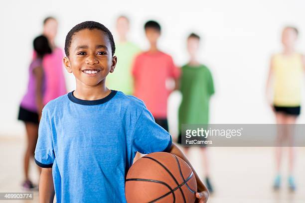 Little boy holding a basketball